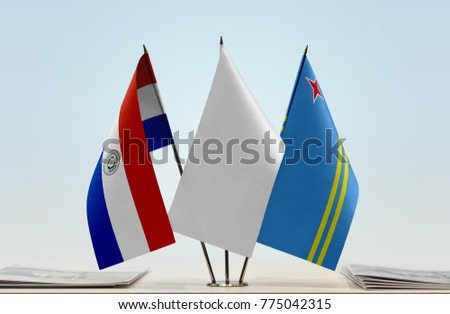 Flags of Paraguay and Aruba with a white flag in the middle