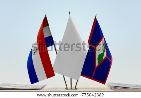 Flags of Paraguay and Sint Eustatius with a white flag in the middle
