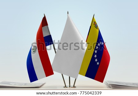 Flags of Paraguay and Venezuela with a white flag in the middle