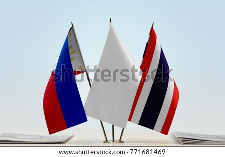 Flags of Philippines and Thailand with a white flag in the middle