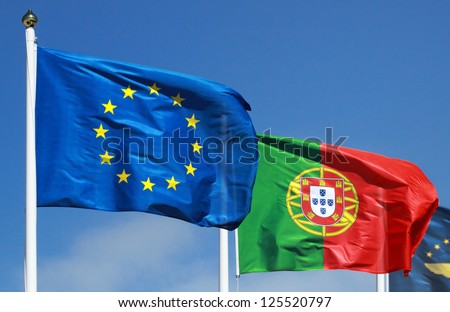 Flags of Portugal and EU in the sun