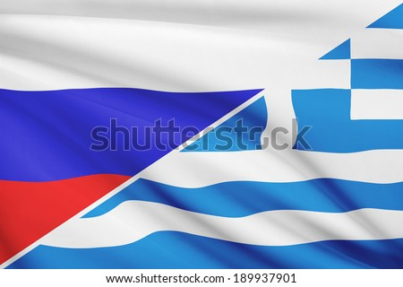 Flags of Russia and Hellenic Republic - Greece blowing in the wind. Part of a series.