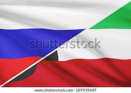 Flags of Russia and State of Kuwait blowing in the wind. Part of a series. - stock photo
