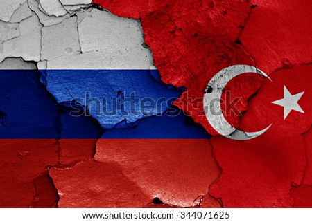 flags of Russia and Turkey painted on cracked wall - stock photo