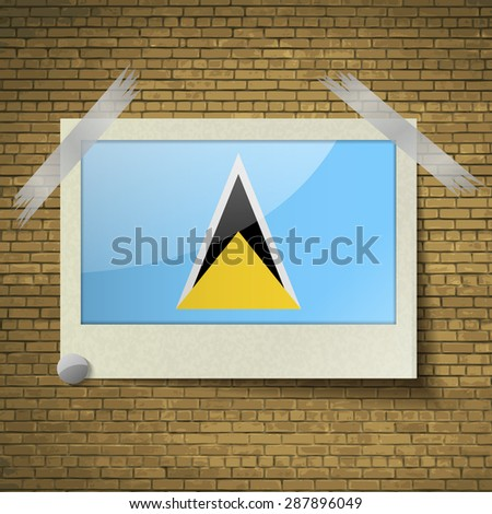 Flags of Saint Lucia at frame on a brick background.  illustration. Rastrized version - stock photo