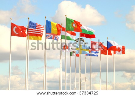 Flags of several countries against the blue sky