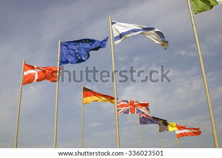 Flags of several countries. Blue sky background.