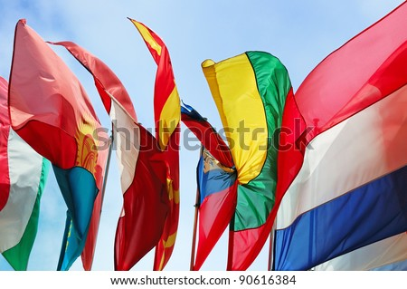 Flags of several Europe states against blue sky - stock photo