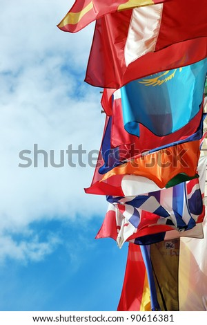 Flags of several Europe states against picturesque cloudy sky - stock photo