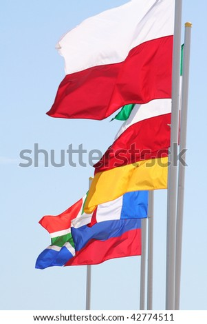 flags of several nations flying together - stock photo