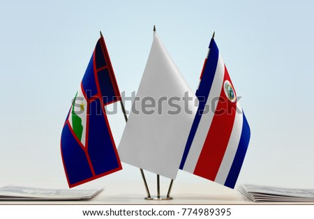 Flags of Sint Eustatius and Costa Rica with a white flag in the middle