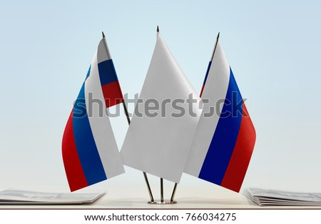 Flags of Slovenia and Russia with a white flag in the middle