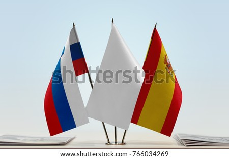 Flags of Slovenia and Spain with a white flag in the middle