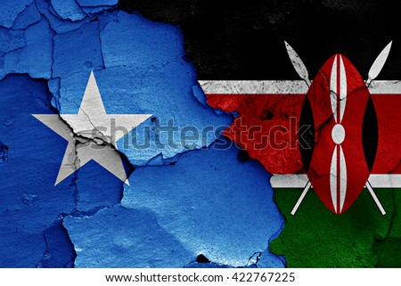 flags of Somalia and Kenya painted on cracked wall - stock photo