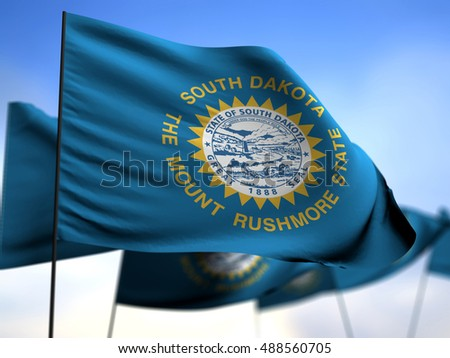 flags of South Dakota on blue sky background 3D