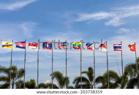 flags of southeast asia countries on blue sky background, AEC, ASEAN Economic Community [ Please see my footage vdo of this photo at www.shutterstock.com/video/video.html?id=7215277 ] - stock photo