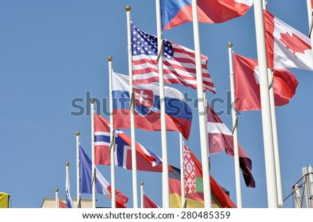 flags of states on masts - stock photo