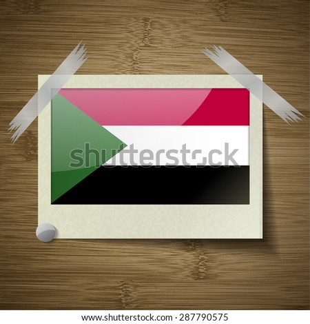 Flags of Sudan at frame on wooden texture.  illustration. Rastrized version - stock photo