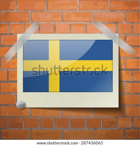 Flags of Sweden scotch taped to a red brick wall.  Rasterized version - stock photo