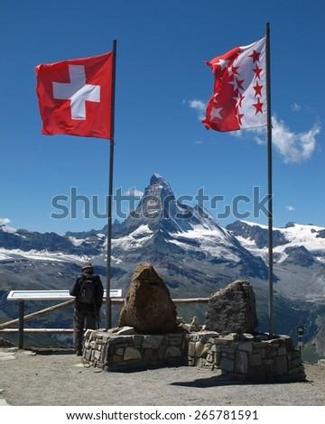 Flags of Switzerland and Wallis Canton, Matterhorn - stock photo