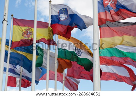 Flags of the countries of the world wave on a wind - stock photo