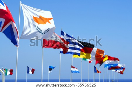 Flags of the EU against blue sky - stock photo