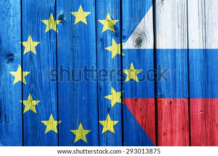 Flags of the European Union and Russia on the background of the old wooden texture - stock photo