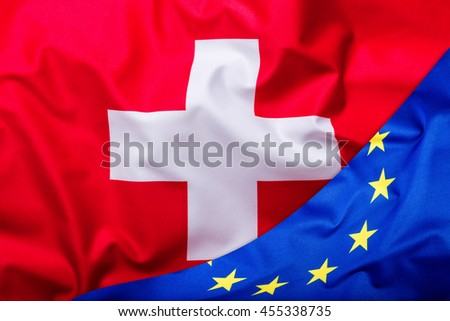 Flags of the switzerland and the European Union. Switzerland Flag and EU Flag. World flag money concept. - stock photo