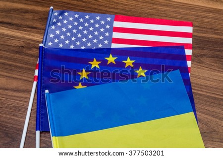 flags of the USA, Europe and Ukraine - stock photo