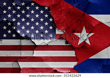 flags of USA and Cuba painted on cracked wall