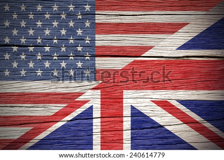 Flags of USA and United Kingdom over a Wooden Background - stock photo