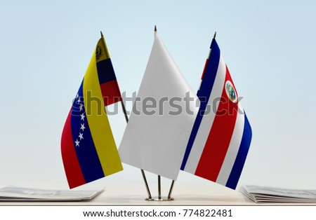 Flags of Venezuela and Costa Rica with a white flag in the middle