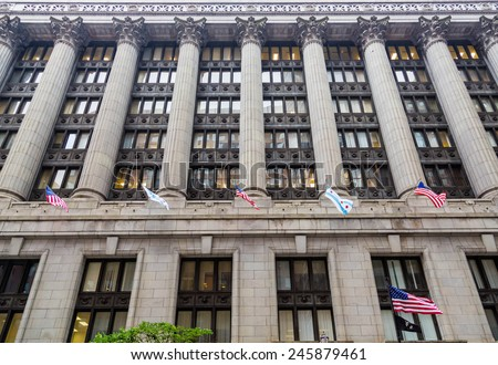 Flags on a Massive Old Stone Chicago Building - stock photo