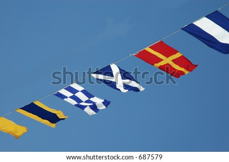 Flags on a ship. - stock photo