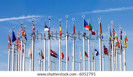 Flags on blue sky background. - stock photo