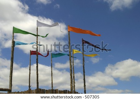 Flags on poles and blue sky - stock photo