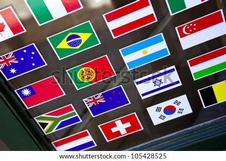 Flags stickers on a shop window - stock photo