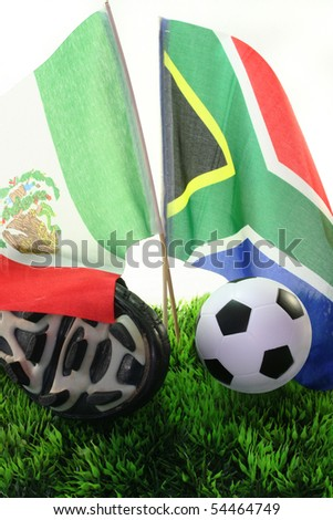 Flags with leather ball and soccer shoes on a white background