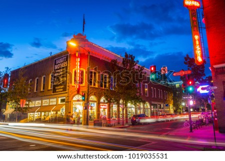 FLAGSTAFF, ARIZONA, USA- June 2, 2017: Beautiful view of the historic city center of Flagstaff with famous Hotel Monte Vista on cloudy day in winter in northern Arizona American Southwest USA