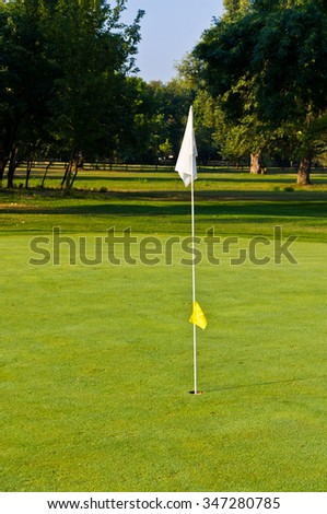 Flagstick is a marker used to indicate the position of the hole on a green in a golf course, Belgrade, Serbia