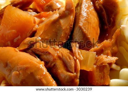 Flaked tuna in a tomato sauce - stock photo