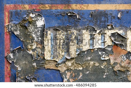Flaking paint on an old barge
