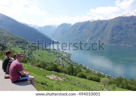 FLAM - 31 MAY: Appreciating the beautiful fjord in Flam, Norway on 31 May 2016. The picture was taken on the way back to Flam after visiting stegastein viewpoint