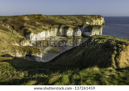 Flamborough, Yorkshire, UK. view of the high chalk cliffs at Flamborough Head showing the sheer height of the cliffs and the effects of sea erosion shot on a bright spring morning.