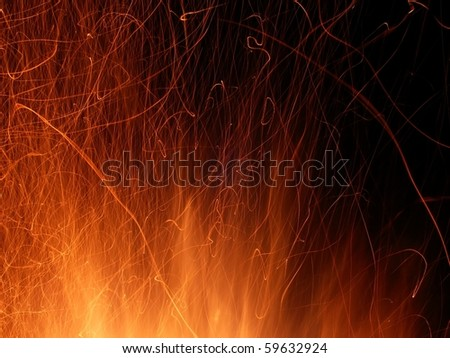 Flame and sparks light up the night - stock photo