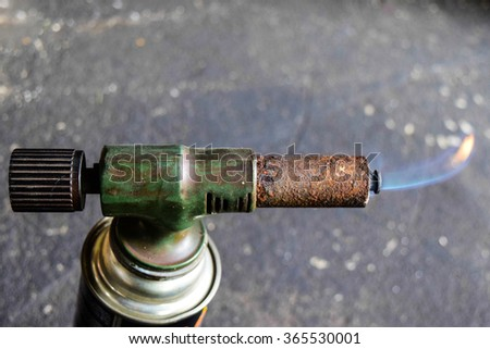 Flame blowtorch from Gas cans - stock photo