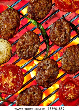 Flame broiled meatballs - stock photo