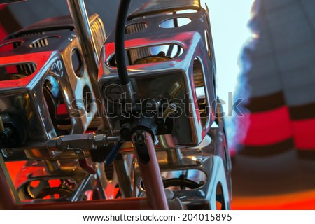flame burner in red hot air balloon flying - stock photo