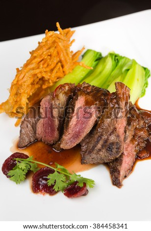 Flame grilled ,rare kangaroo steak loin, served with pak choi and a red wine sauce