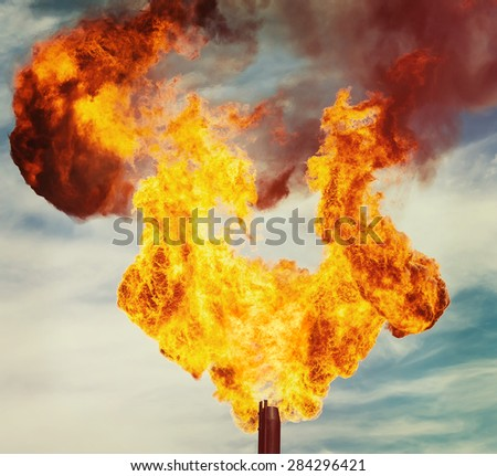 Flame of an oil torch in the sky close up - stock photo